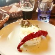 Have a beer and some typical Bohemian food such as pickled cheese